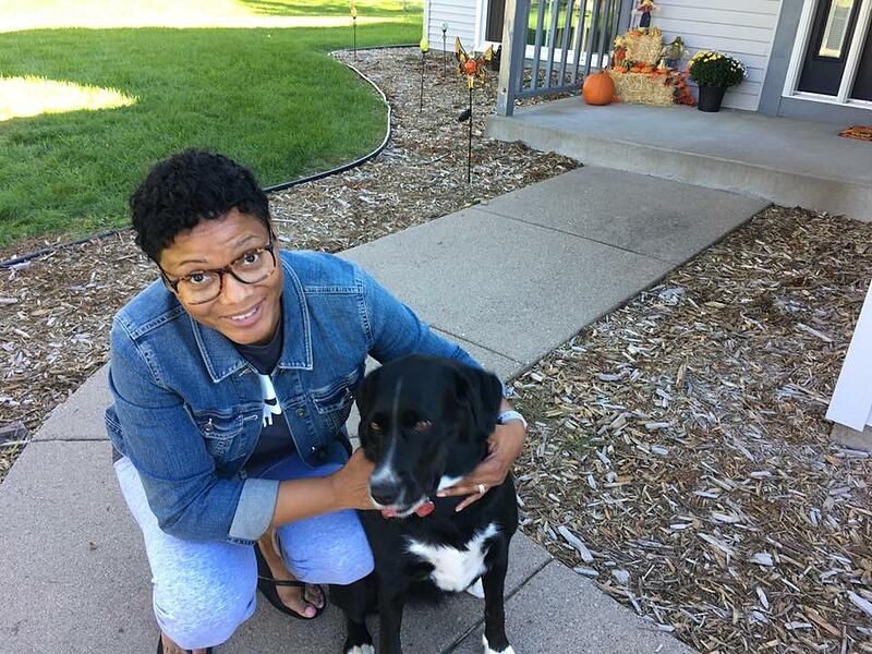 Shereese with her dog in the front yard
