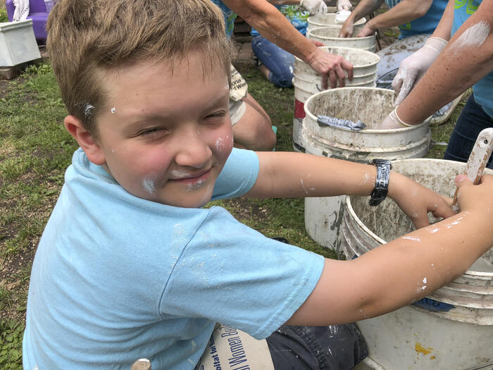 Erik helping the volunteers with paint
