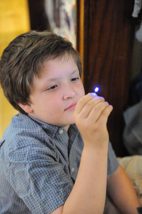 Erik holding his soldering kit