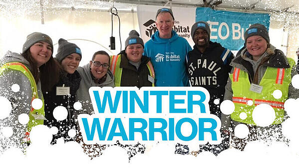 "Blue text reads ""Winter Warrior"" with an abstract snow border at the bottom. The photo behind the text is of AmeriCorps members and volunteers wearing Winter Warriors hats and posing with Chris Coleman at the CEO Build."