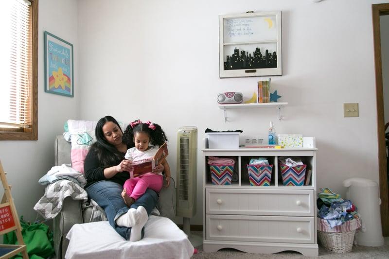 Kera reading to her daughter