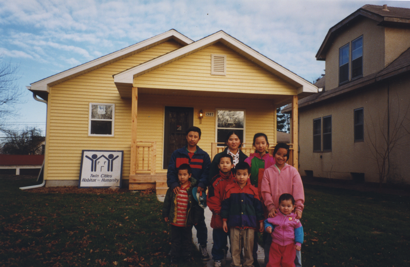 Naja's family in front of their new Habitat home - 1999
