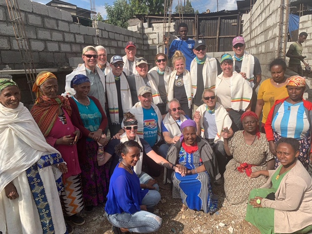A group photo of the volunteers and homeowners in Addis Ababa.