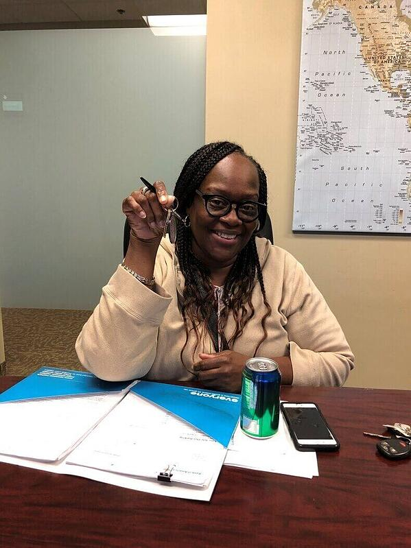 Wendy Mitchell holding her keys at her home closing.