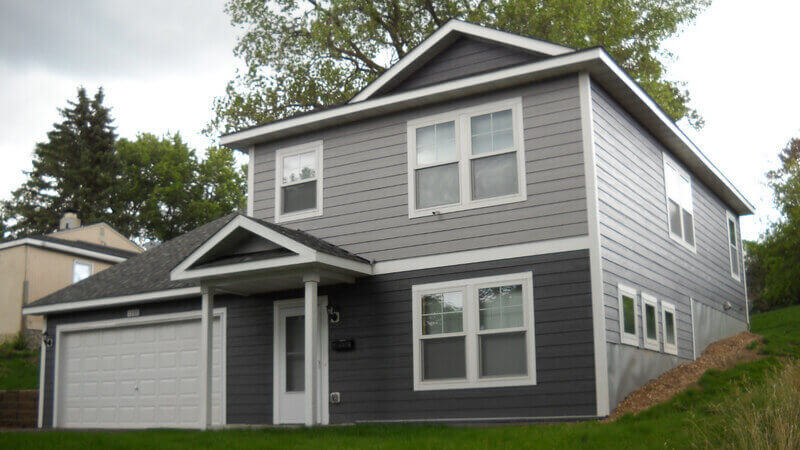 A two-story gray Habitat home.