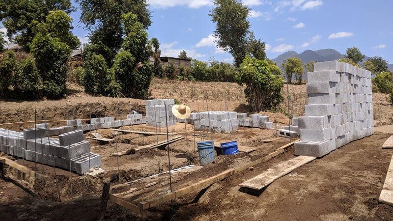Concrete blocks laid out around a build site.