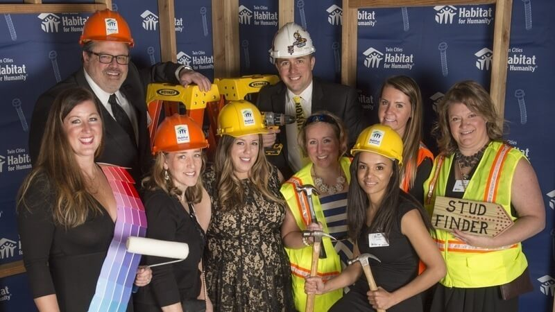 A group at the 2019 Hard Hat & Black Tie Gala, wearing a variety of construction-related costumes.