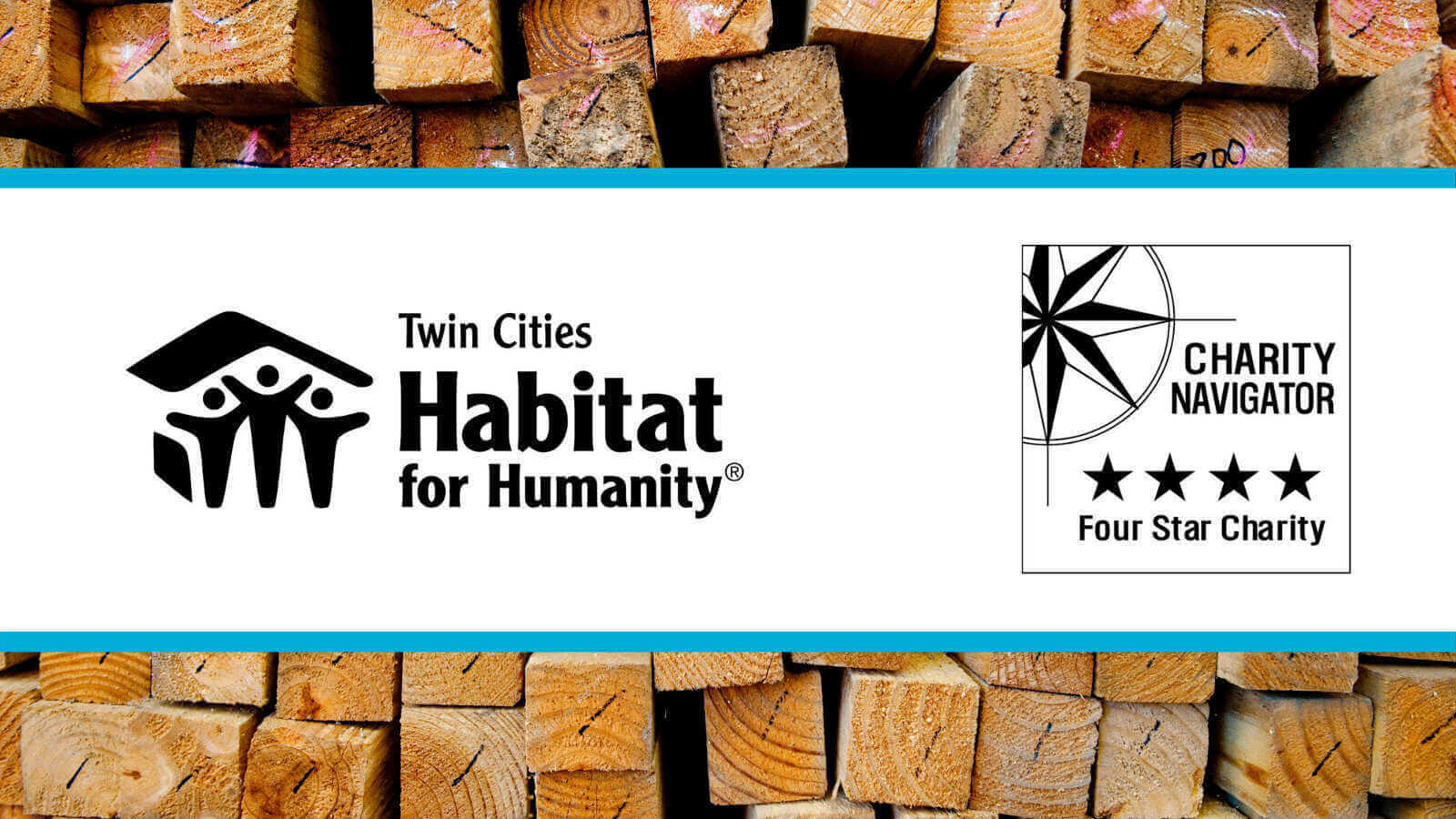 A white banner overlaying an image of the end of a pile of wooden beams. The white banner is framed by a light blue band. Inside the banner is the Twin Cities habitat logo on the left, and the Charity Navigator four-star logo on the right. Both are in black.
