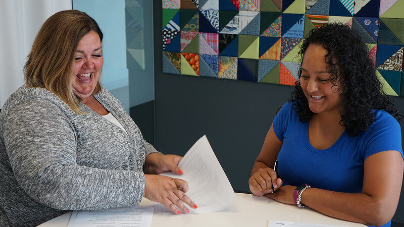 A Habitat homeowner going over paperwork with her loan officer.