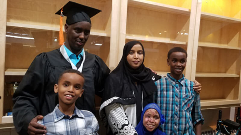 Mahdi and his family at his graduation.