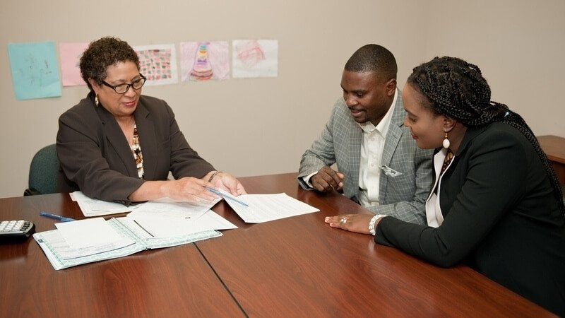 A couple going over their taxes with a tax advisor.