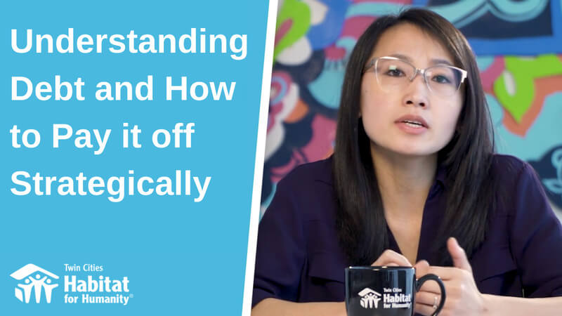 "Pa Lor in front of a colorful background to the right; to the left, a blue background with white text saying ""Understanding Debt and How to Pay it off Strategically."" The white TC Habitat logo is at the bottom."