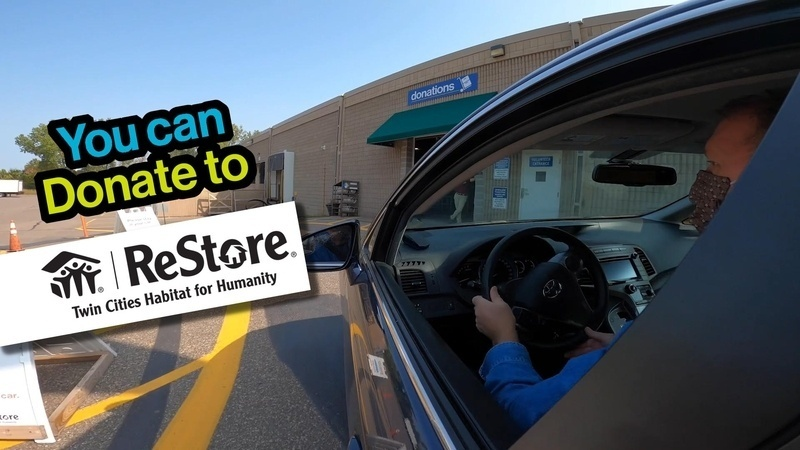 "The text ""You can donate to ReStore"" in front of a picture of a person driving a car."