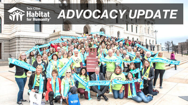 """A group of Habitat advocates with a gray transparent banner saying """"Advocacy Update"""" at the top with the TC Habitat logo."""