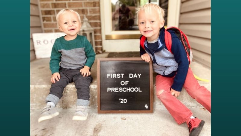 Bethany's children next to a first day of school sign