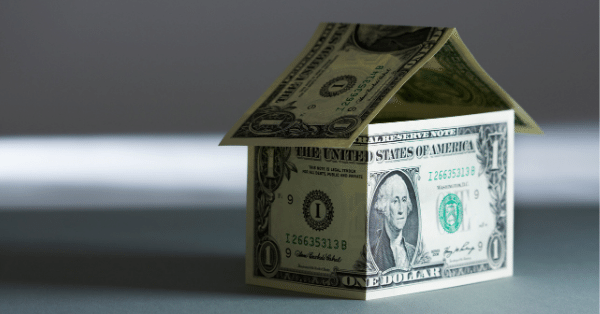 A tiny home that is shaped out of dollar bills
