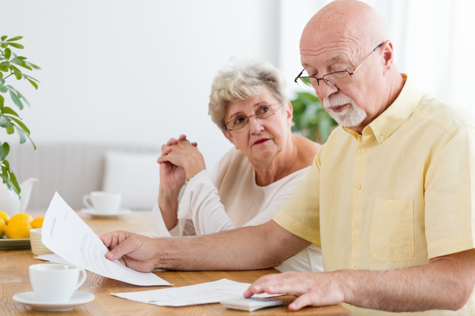 How Much Does it Cost to Age in Place? - elderly couple, paperwork, cost, calculator – TC Habitat