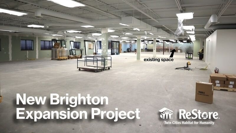 "The interior of the New Brighton location under construction. White text says ""New Brighton Expansion Project"" with the ReStore logo at the bottom right."