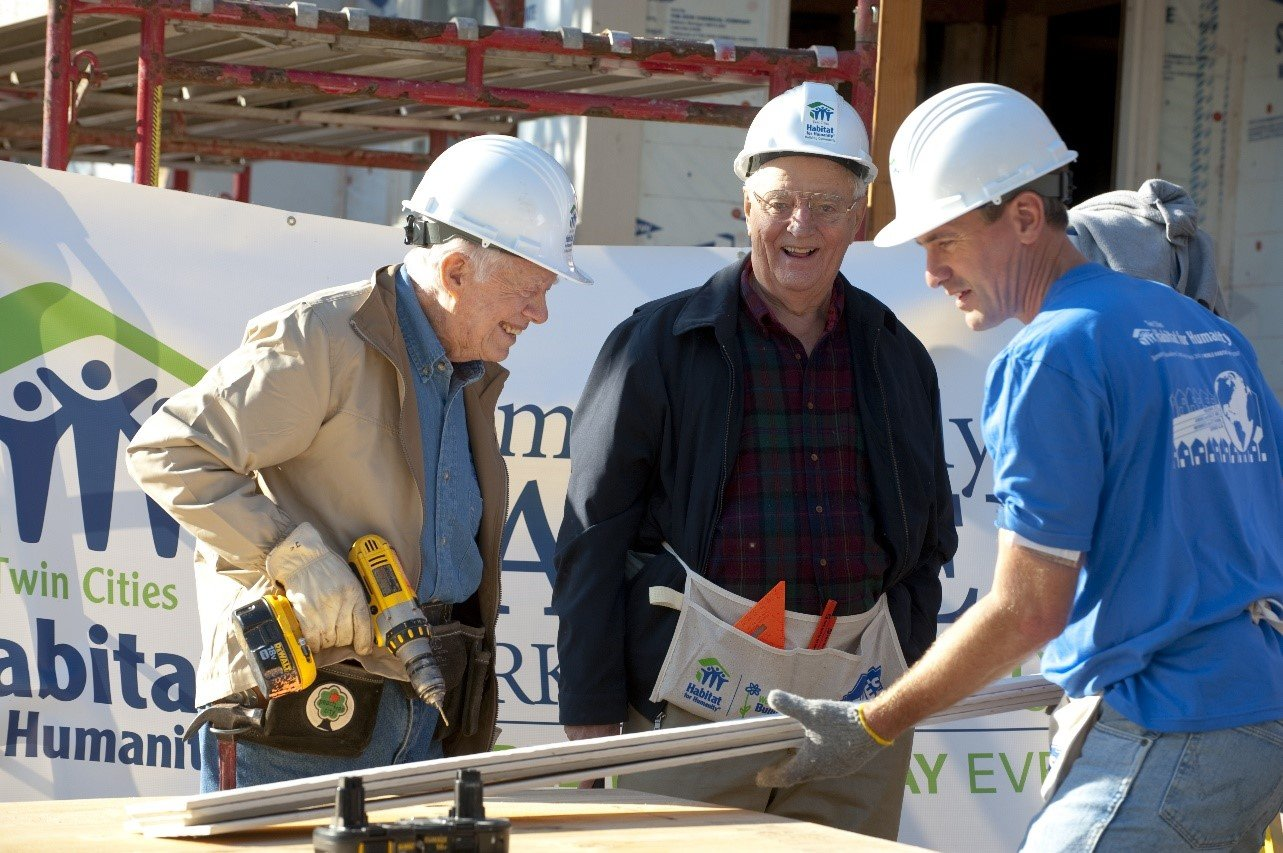 Walter Mondale helps build with Jimmy Carter and R.T. Rybak during the Carter Build in Minneapolis in 2010