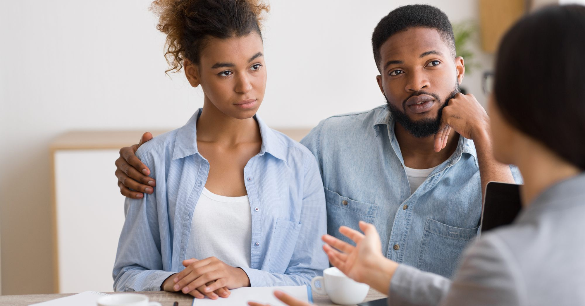 First-time homebuyer couple speaking with a financial advisor on using their 401(k) to buy a home.