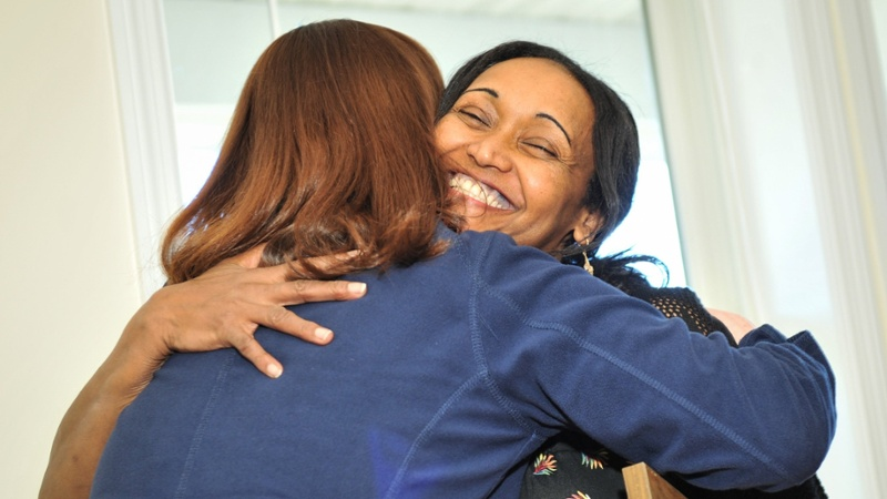 Two people share a hug at a Twin Cities Habitat for Humanity Home Celebration