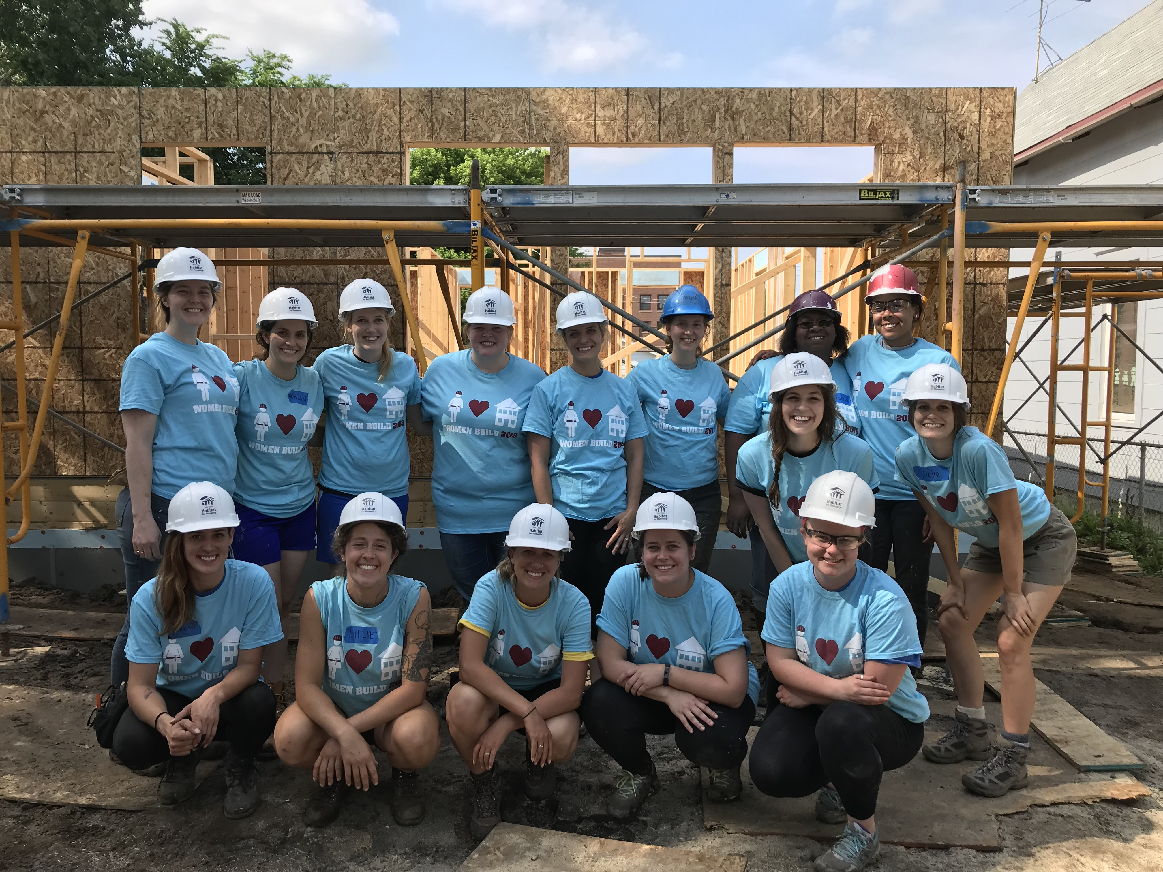 women build staff day group photo