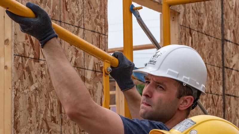 Campaign Council member Jake Loesch volunteering on a Habitat build site.