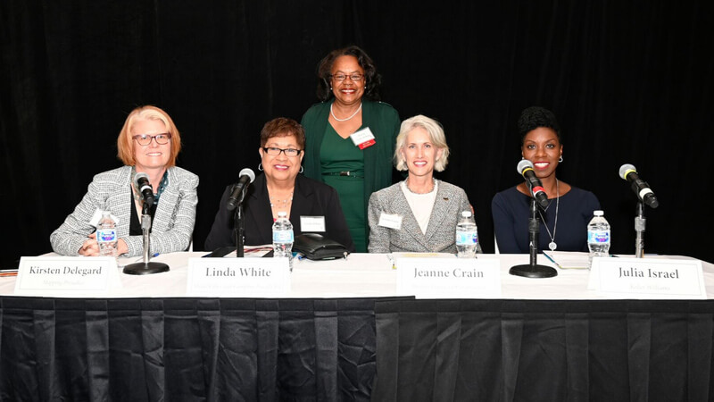The panel of speakers at the Habitat Hope Builder's Luncheon. From left to right: Kristen Delegard, Linda White, moderator Sharon Sayles Belton, Jeanne Crain, and Julia Israel.