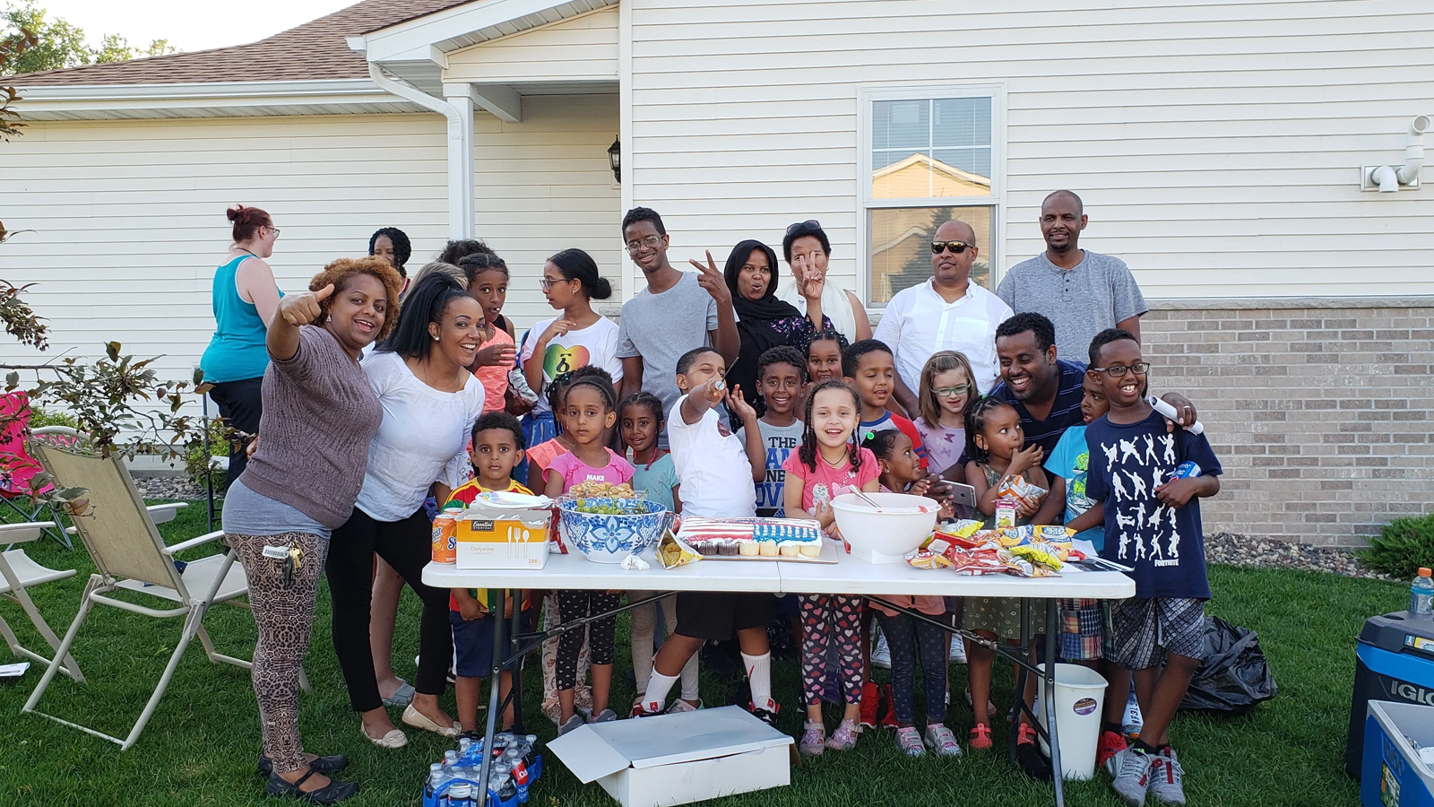 Hugo homeowners and kids at table